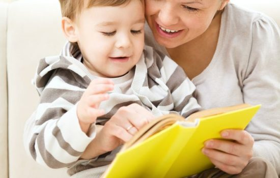 16382643 - mother is reading book for her son, indoor shoot